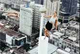 Woman Climbing A Tower In A Mini Skirt